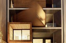 Sharifi-ha House à noite, com um bloco aberto, outro em movimento e o último fechado. Next Office