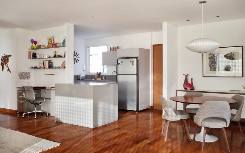 escritório integrado com sala e cozinha